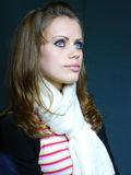 Blue-eyed brown-haired woman in a white scarf. Young blue-eyed brown-haired woman in a white scarf Stock Photos