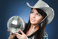 Blue-eyed brunette with disco ball Royalty Free Stock Photography