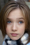 Blue Eyed Child. Little girl with striped scarf Royalty Free Stock Images