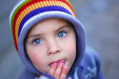 Blue eyed child looking up Stock Photography