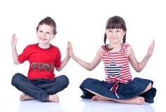 Blue eyed children posing Royalty Free Stock Image