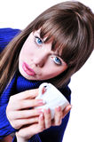 Blue-eyed drinking girl with cup stock photography