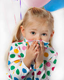 Blue-Eyed Girl with Balloons Stock Image