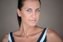 Blue-eyed girl with dark hair Royalty Free Stock Photos