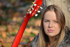 Blue eyed girl with guitar Royalty Free Stock Image