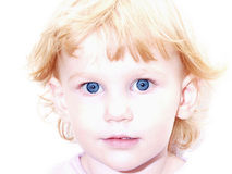 Blue Eyed Girl with Strawberry Blond Hair. This darling girl's blue eyes pierce right through you Royalty Free Stock Images