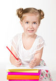 Blue-eyed girl wiht red pencil looking at camera Royalty Free Stock Photography