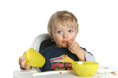 Blue eyed little boy eating pasta Royalty Free Stock Images