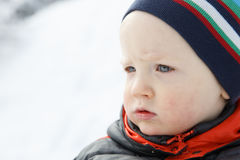 Blue eyed little boy in a winter landscape Stock Photography
