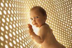 Naked baby with rays of light network. Blue-eyed, a little naked baby rays of light network stock images