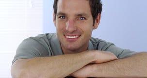 Blue eyed man smiling at camera Royalty Free Stock Image