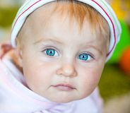 Blue-eyed toddler Stock Photos