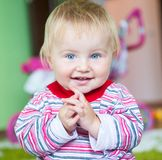 Blue-eyed toddler Stock Images