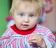 Blue-eyed toddler Stock Photos