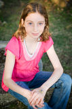 Blue eyed tween girl Stock Photo