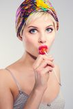 Blue eyed vintage girl with lollipop Stock Images