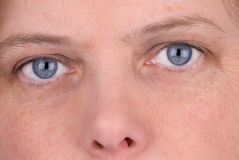 Blue eyed woman Stock Photography