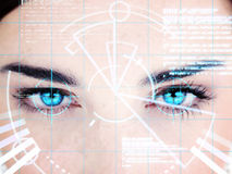 Blue eyed woman with interface Stock Photos