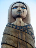 Blue-eyed woman Maori carving Stock Photos
