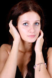 Blue-eyed woman over black Royalty Free Stock Images