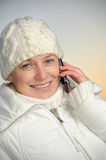 Blue-eyed woman on phone Stock Photos