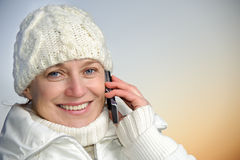 Blue-eyed woman on phone Stock Image