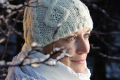 Blue-eyed woman in white in the winter forest. Stock Photography