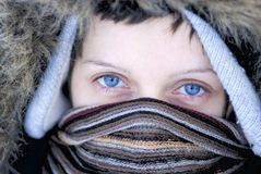 Blue eyed woman in winter clothes Stock Images