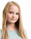 Blue Eyed Young Girl in Turquoise Top Isolated. Portrait of a young blue eyed teenage girl with long blond hair wearing a turquoise blue green top with a neutral Stock Photos