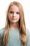 Blue Eyed Young Girl in Turquoise Top Isolated. Portrait of a young blue eyed teenage girl with long blond hair wearing a turquoise blue green top with a neutral Stock Images