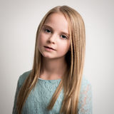 Blue Eyed Young Girl in Turquoise Top Isolated Royalty Free Stock Photos