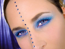 Blue eyes. Close-up shot of a womans face royalty free stock image