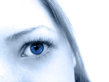 Blue Eyes. Close up on female's blue eye, high key. Focus on the eye royalty free stock photography