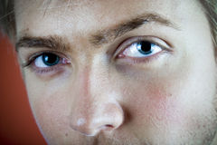 Blue Eyes. Closeup of a 21 year old man's face with with emphasis on his blue eyes Royalty Free Stock Image