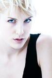 Blue eyes. Young blond woman with blue eyes. studio shot on white background. highkey shot stock photo