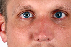 Blue Eyes. Close up of a young man with bright blue eyes Stock Image