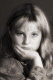 Blue Eyes. Preteen posing while relaxed, sepia with blue eyes Stock Images