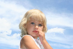 Blue Eyes. Blond girl with blue sky with blue sky in background Royalty Free Stock Photography