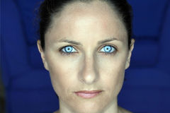 Blue eyes. A portrait of a middle aged female with blue eyes Stock Photo