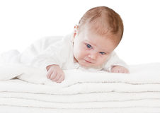 Blue eyes baby boy on white towels Stock Photo