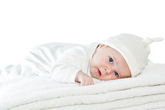 Blue eyes baby boy on white towels Royalty Free Stock Images