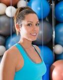 Blue eyes beautiful girl smiling at gym portrait Stock Photos
