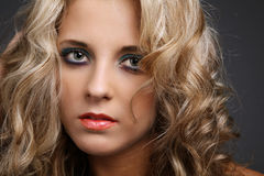 Blue eyes and blond hair. Stock Images