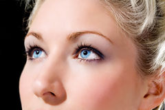 Blue eyes caucasian girl. Caucasian girl with attractive blue eyes looks up, thinking Stock Photo