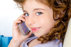 Blue eyes child girl talking mobile phone Stock Images