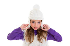 Blue eyes child kid girl with white winter cap fur Royalty Free Stock Photography