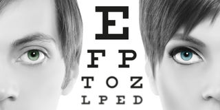 Blue eyes close up on visual test chart, eyesight and eye exam. Ination concept in white background Stock Photo