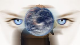 Blue eyes and earth Stock Images