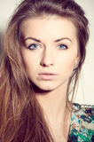 Blue eyes fashion young woman portrait on a white background Royalty Free Stock Photos