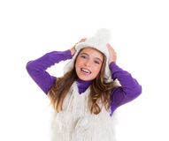 Blue eyes happy child kid girl with white winter cap Royalty Free Stock Image